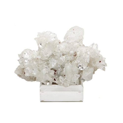 White Apophylite & Haulandite Specimen on Lucite Base White_Apophylite_on_Calcite_Specimen_with_red_and_pink_Haulandite_on_Lucite_Base._Jalgoan,_India_.jpg